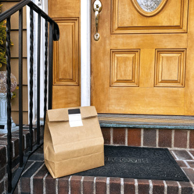 picture of delivery in brown paper bag at door step