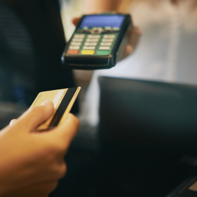 person putting their card in a mPOS